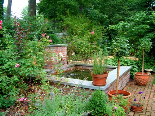 formal pond with fountain and brick walkways