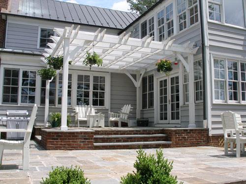 Raised bluestone patio with pergola.